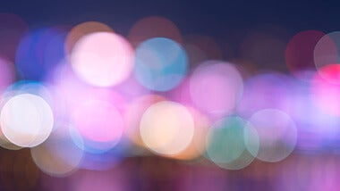 Blur of city traffic lights in hues of purple and blue