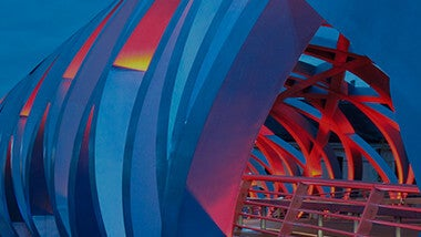 abstract tunnel like structure with walking trail at night in shades of blue orange and red