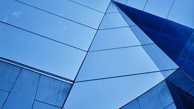 Blue modern building with sharp angles