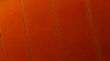 An orange wall with lines
