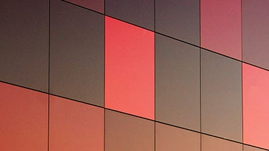 Collection of bright and dark red tiles on a wall